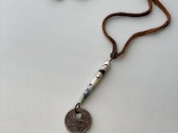 key and paper bead with leather cord