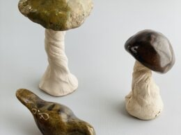 two pottery mushrooms and one pottery bird