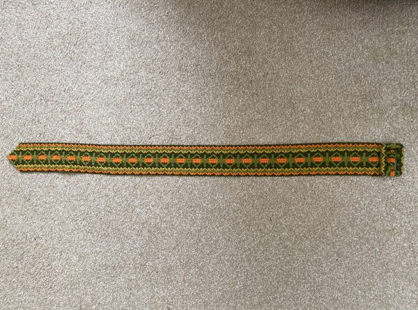 vintage green, yellow, and orange belt
