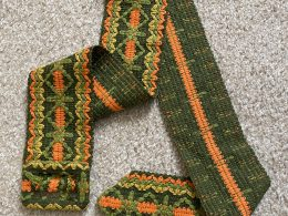 vintage green, yellow, and orange belt